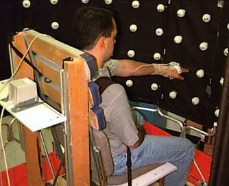 color photograph of a person using a robotic arm