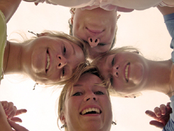 four blond heads looking down at the camera