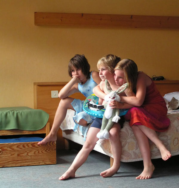 photo of three children sitting on a bed. Photo used by permission: Luc Sessel, Agedem, Belgium