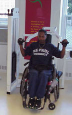 Man in a wheelchair using a weight machine to exercise